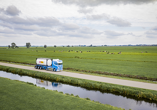 Truck with Tank Container in green field